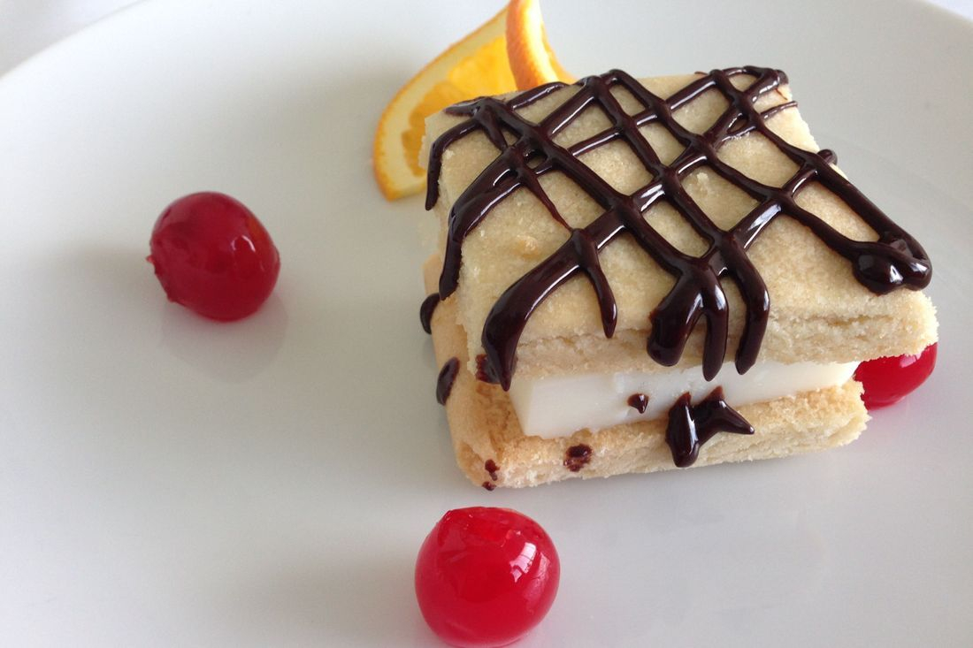 Shortbread custard sandwich with dark chocolate drizzle