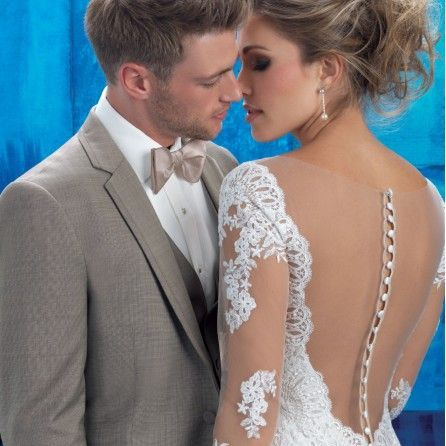 tuxedo bride and groom romantic pose kissing classy