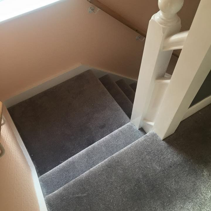 Grey stairs carpet including half landing
