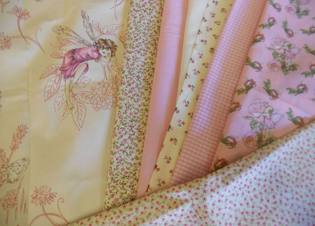 Jane Churchill Meadow Fairy fabrics with pinks, greens and creams.