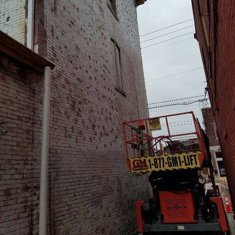 Glue Removal  and paint removal from brick walls