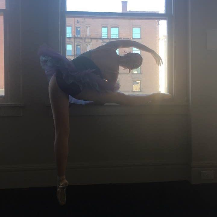 Inland Northwest Ballet dancer poses on pointe at the Bing Crosby Theater in preparation for her ballet solo.
