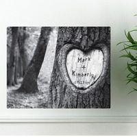 "DETAILS: Tree of Love Canvas Print exemplifies a couple commitment in a time honored way. A tree carved in the couples names with a date is the perfect gift that will also serve as a piece of art. Personalized and Printed on Streched canvas.  SIZE: 24"" x 18""  PERSONALIZATION: Name 1 and Name 2 up to 10 characters and a Date up to 8 characters (numbers as shown)."