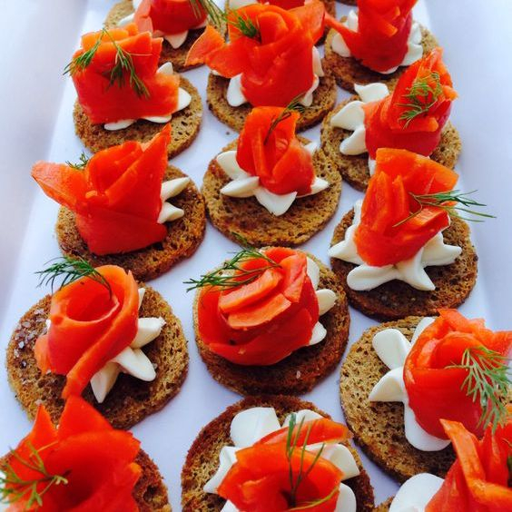 Smoked salmon on pumpernickle crostini with dill cream cheese