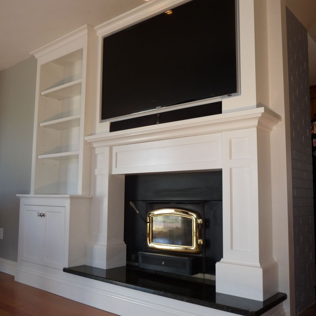 Custom fireplace mantle, TV cabinet, Entertainment Center, and Built-in Cabinet and Bookcase