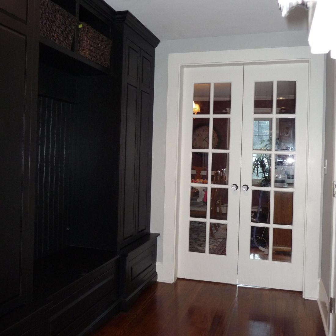 custom antiqued black mudroom