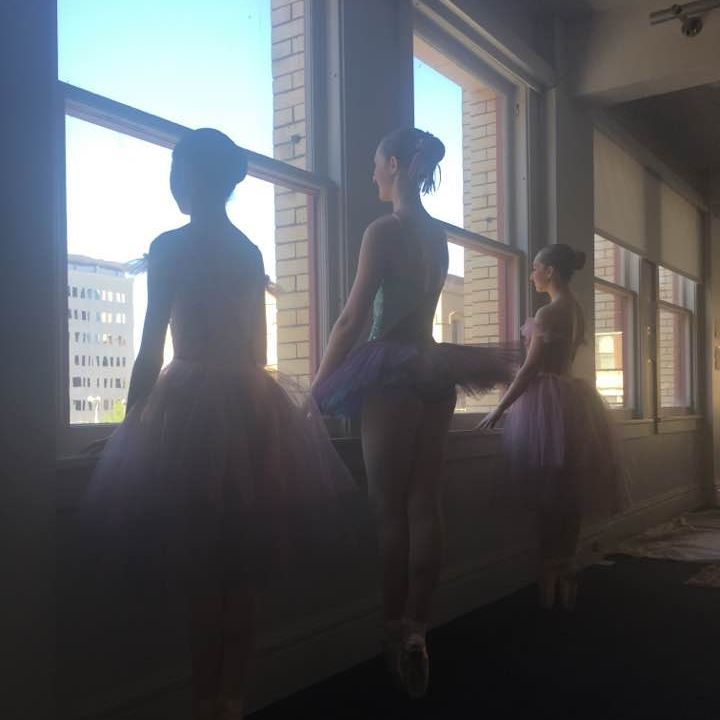 Our dancers perform barre exercises to warm their muscles before taking the stage at the Bing Crosby Theater.