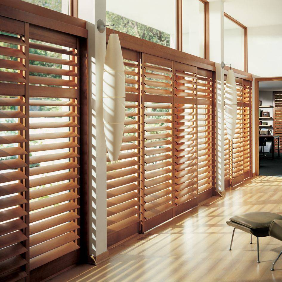 Hunter Douglas offers three types of shutters, Heritance Hardwood, NewStyle Hybrid and Palm Beach Polysatin, all of which are ideal for sliding glass doors.