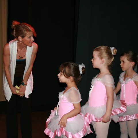 Miss Janine helps prepare our little ones backstage at dress rehearsal.