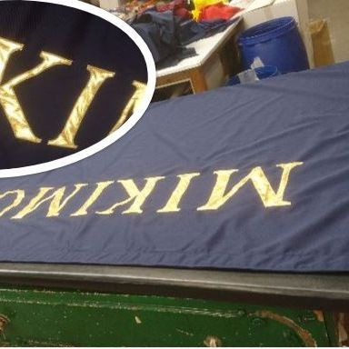Hand sewn, applique letters,  Mikimoto flag for London Store