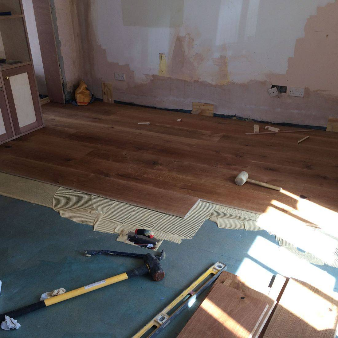 Self levelling anahydrate screed primed ready to apply directly fixed Oak floor boards.