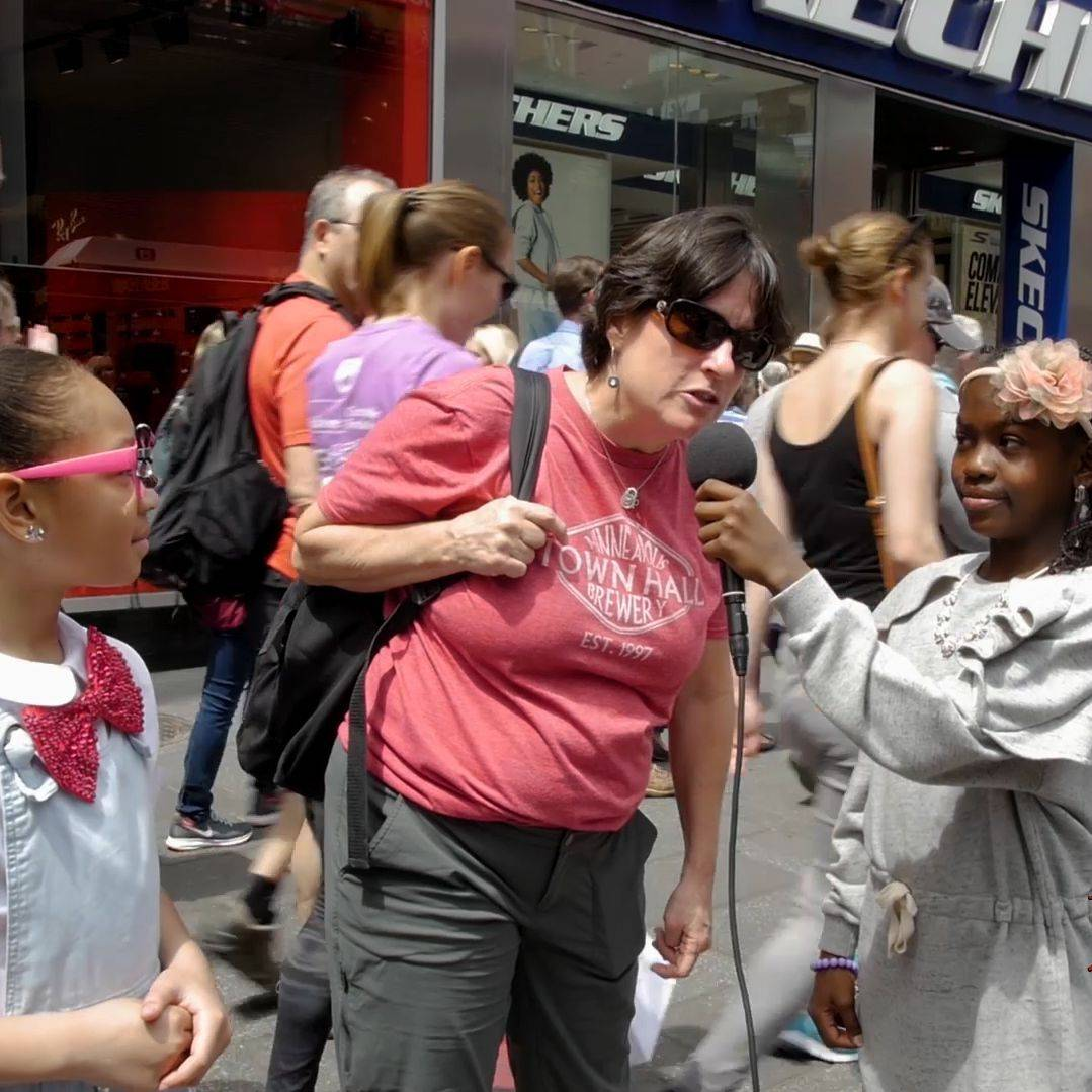 children interviewing on the streets of NYC