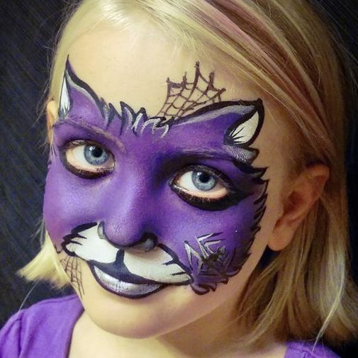 A face painters new design just for this happy little girl's October birthday party