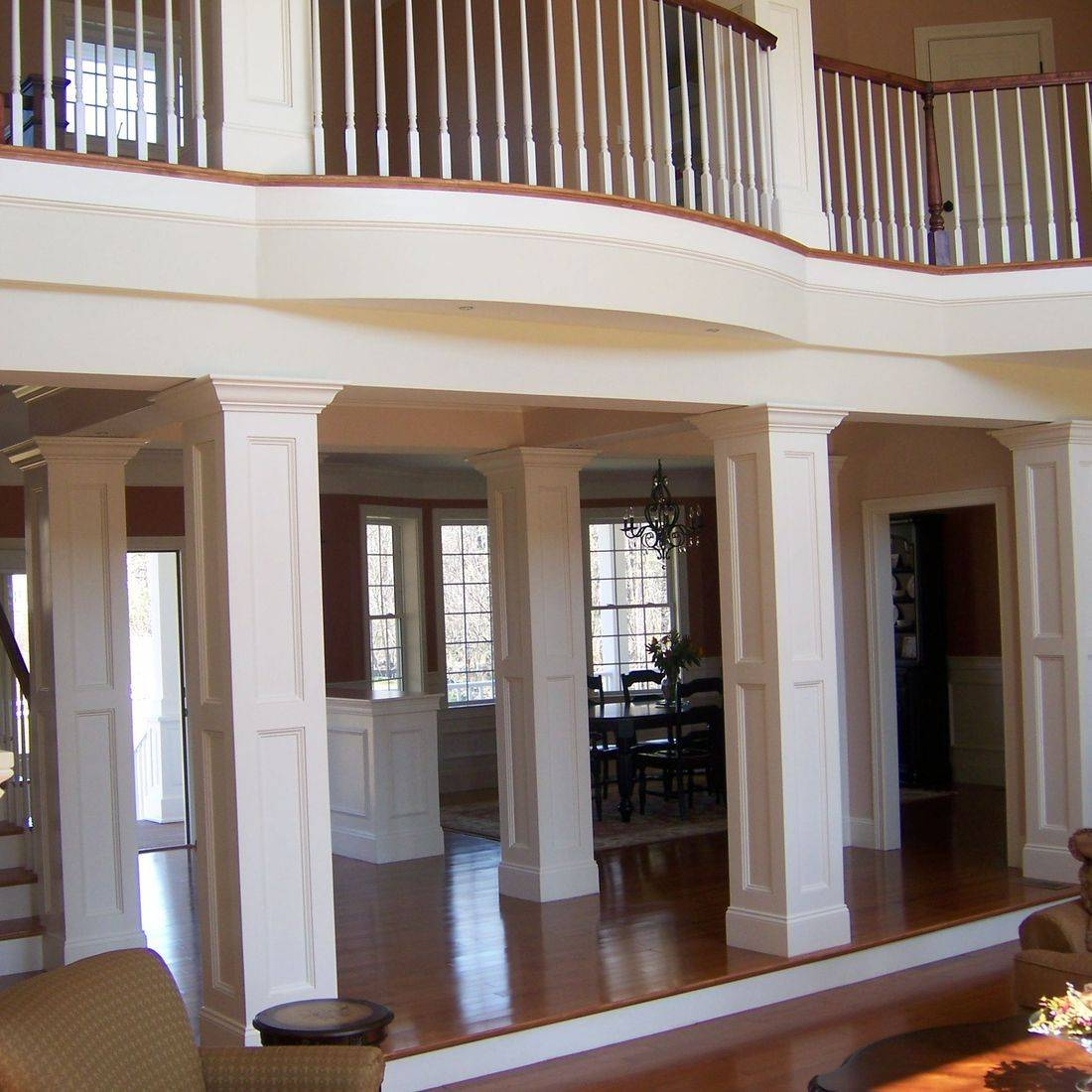 custom foyer columns, curved balcony rail