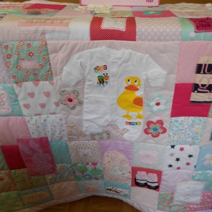 Quilts made from precious baby clothing