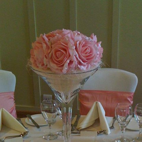 Cocktail vase filled with artificial pink roses
