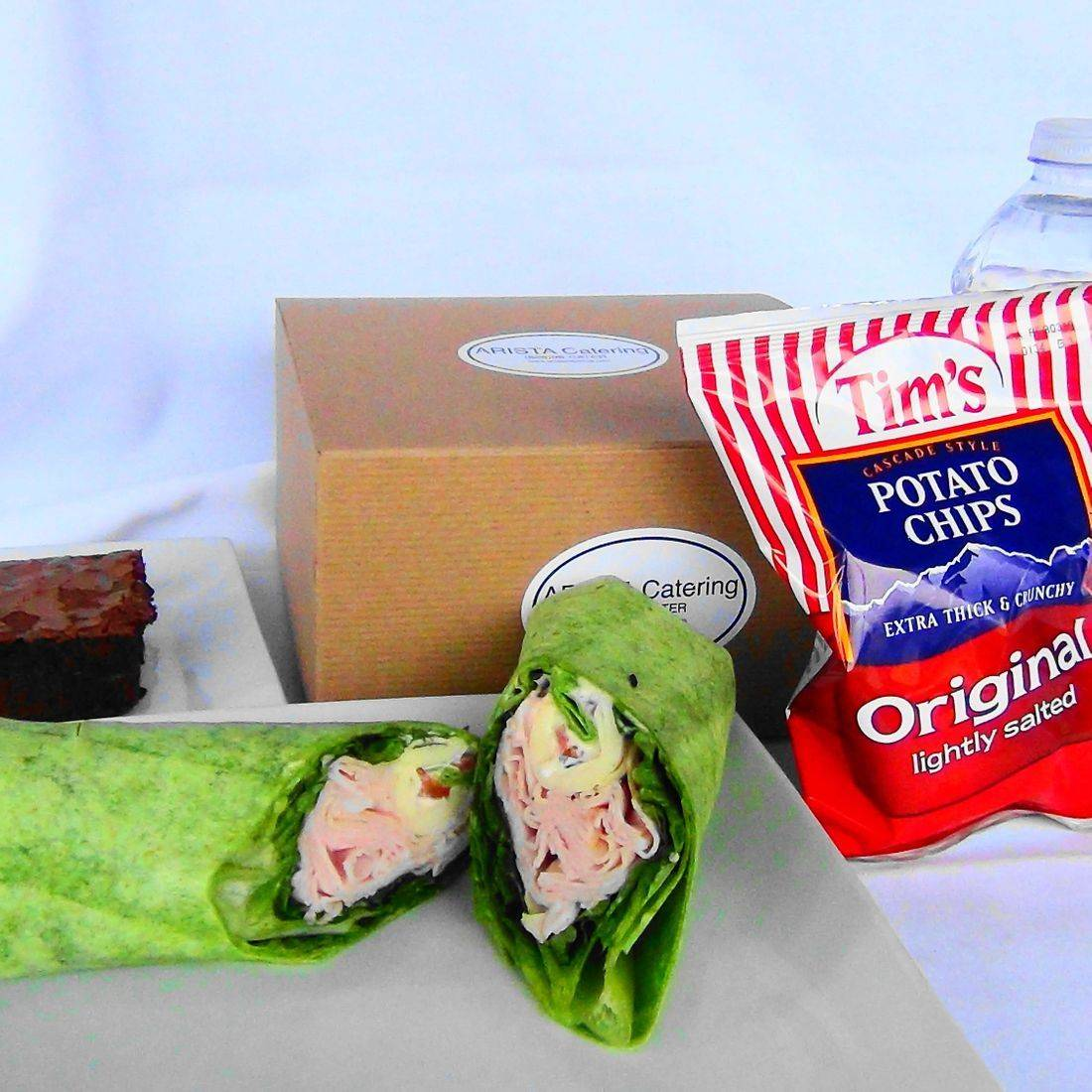 Wrap sandwich catering by ARISTA turkey provolone