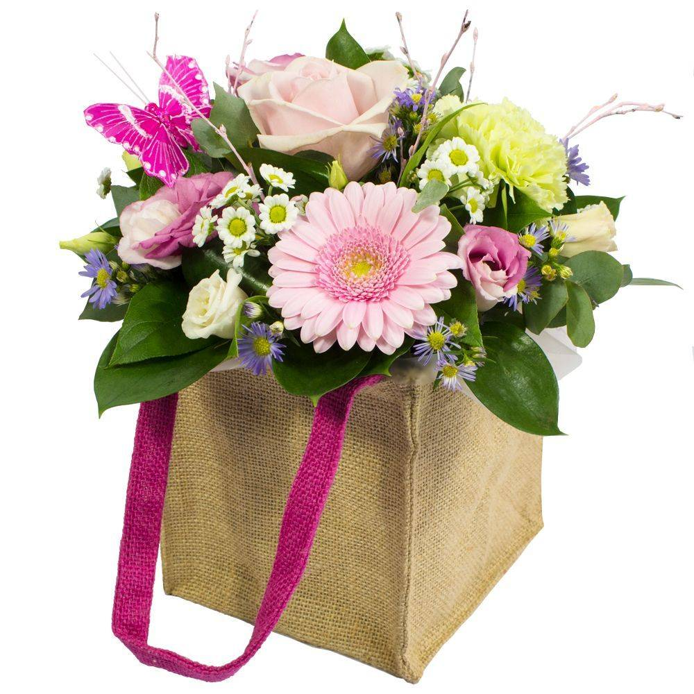 Send your love with Hugs and Kisses, a floral creation presented in a bag