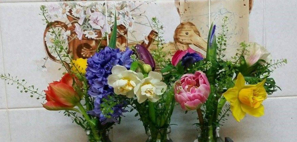 Flowers milk bottles