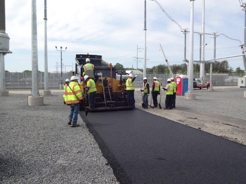 installing asphalt at Keys Energy Power Plant