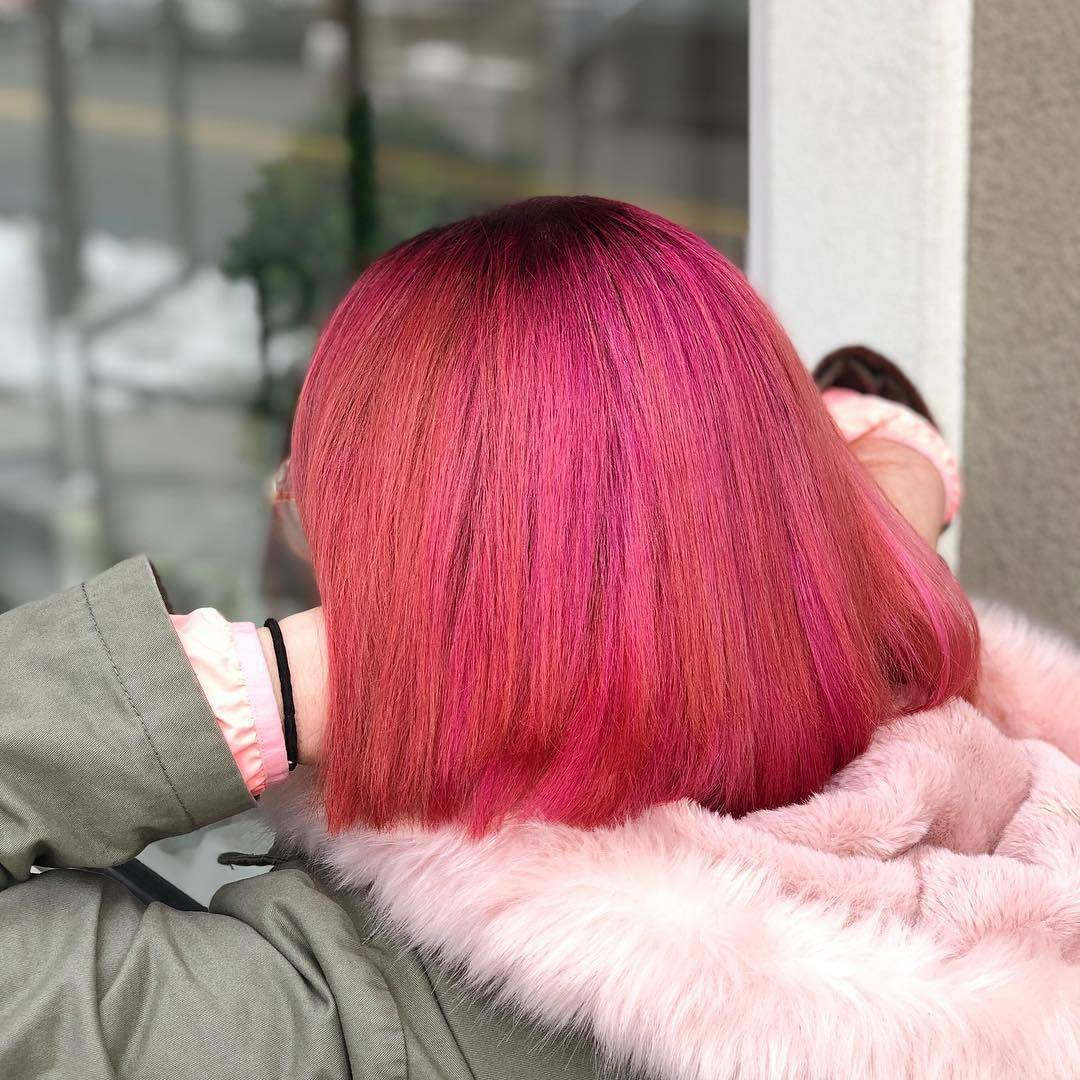 Hot pink and peach hair with blunt haircut