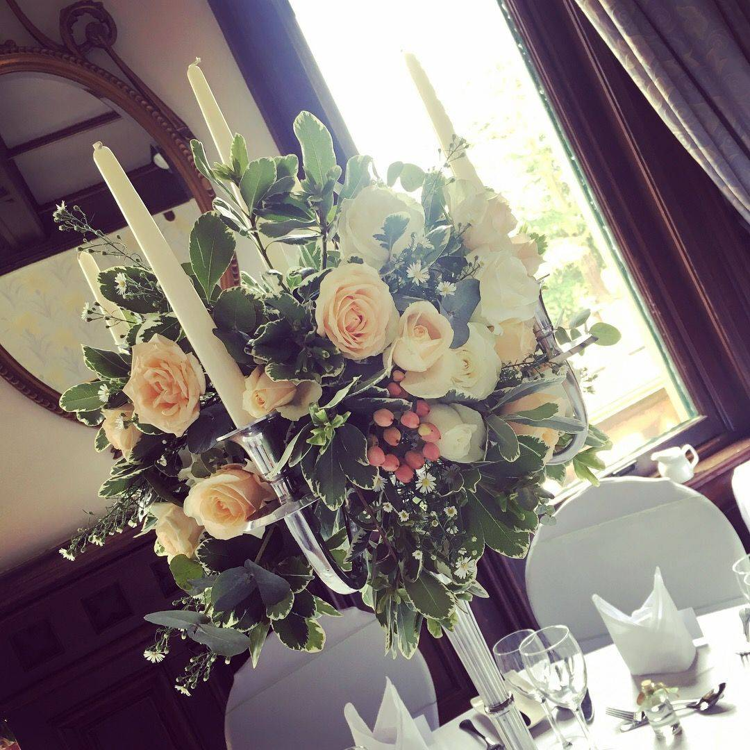 Flower Candelabra, Wroxall Abbey, Centrepieces, wedding florist solihull Warwickshire