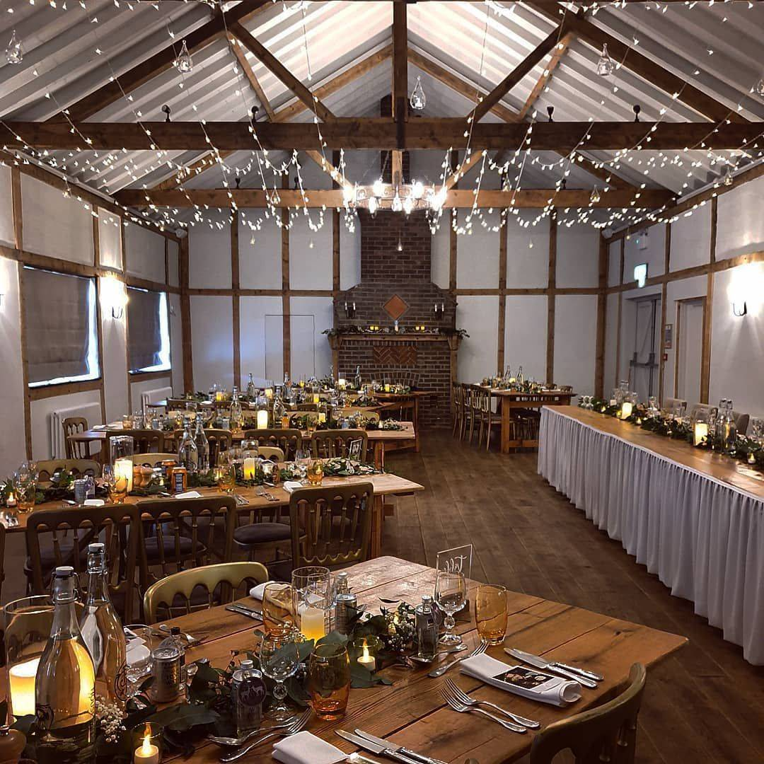 The barn at Burley Manor, decorated for a wedding reception by Love By Design Weddings.