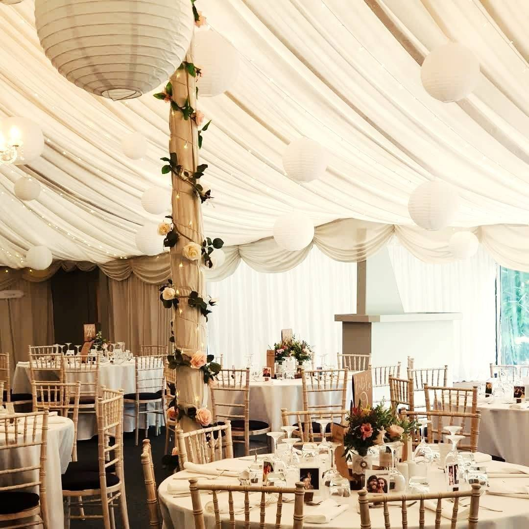Simple, elegant white rustic wedding decor at The Old Vicarage