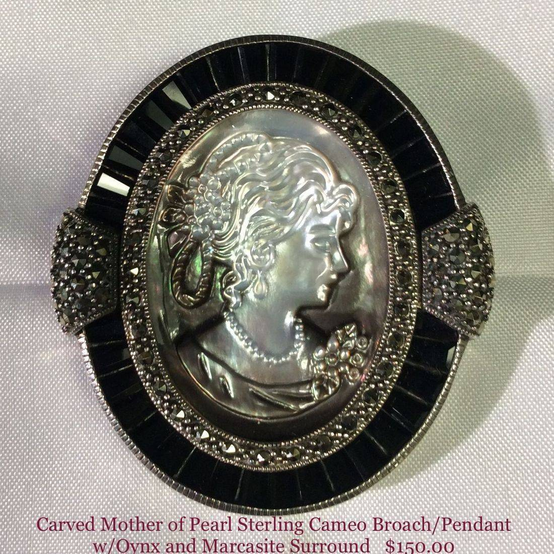 """Carved Mother of Pearl, 925 Sterling Silver, Cameo Brooch/pendant, w/Baguette-cut Oynx and Marcasite surround, 2-1/4"""" X 2""""  $150.00"""