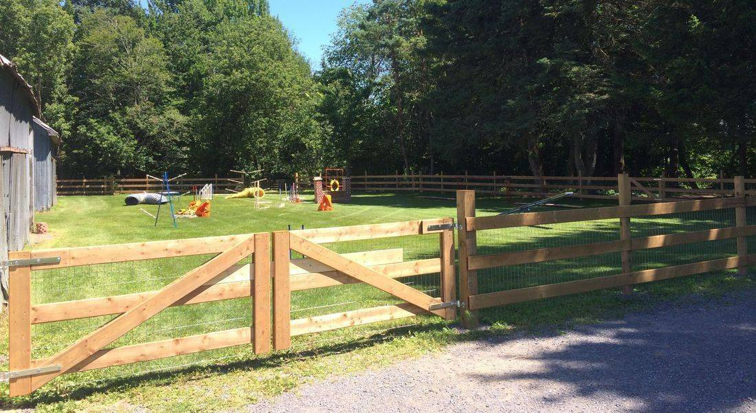 Top Skill K9  dog agility training field, obstacles and fence.