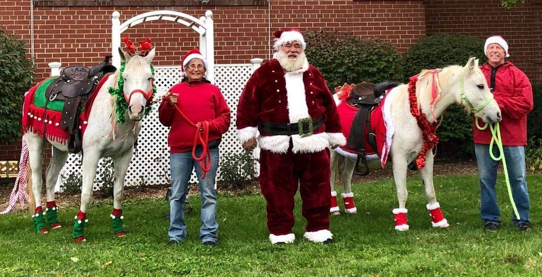 Santa and a white pony and white horse