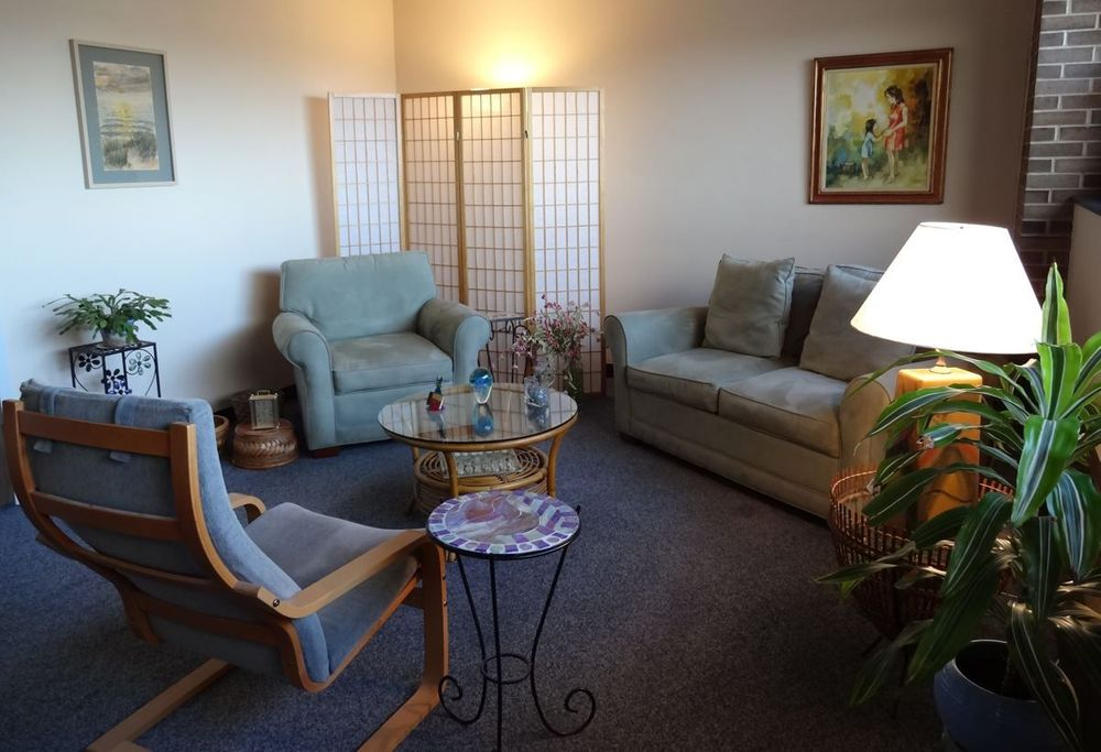 image of a tastefully decorated  therapy office with two chairs and a couch