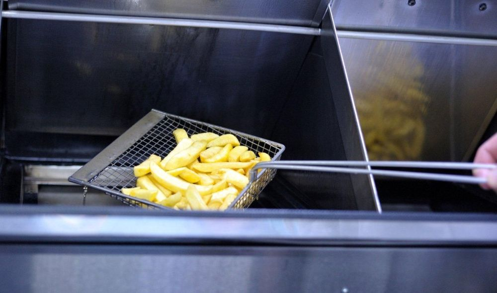 Freshly cooked real chips being lifted from our fish and chip van range.