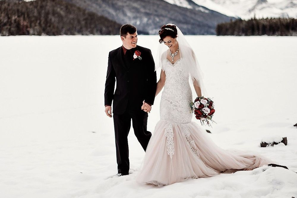 Blush wedding gown with ivory lace, maligne lake, mountain winter elopment , forest, trees, roses, veil, tiara