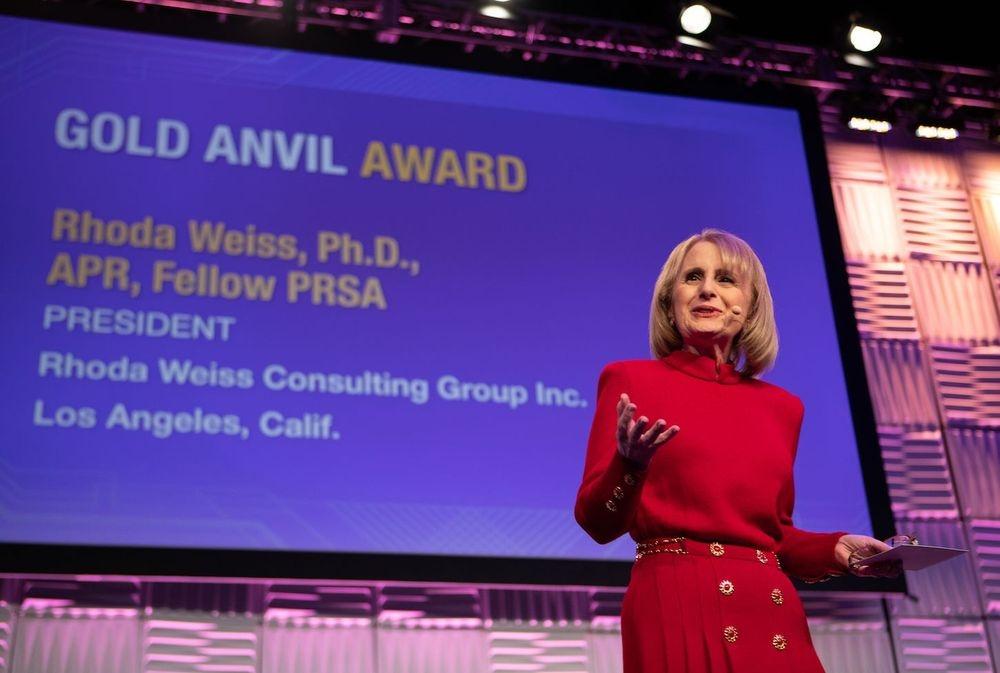Rhoda Weiss giving acceptance speech for PRSA Gold Anvil Award