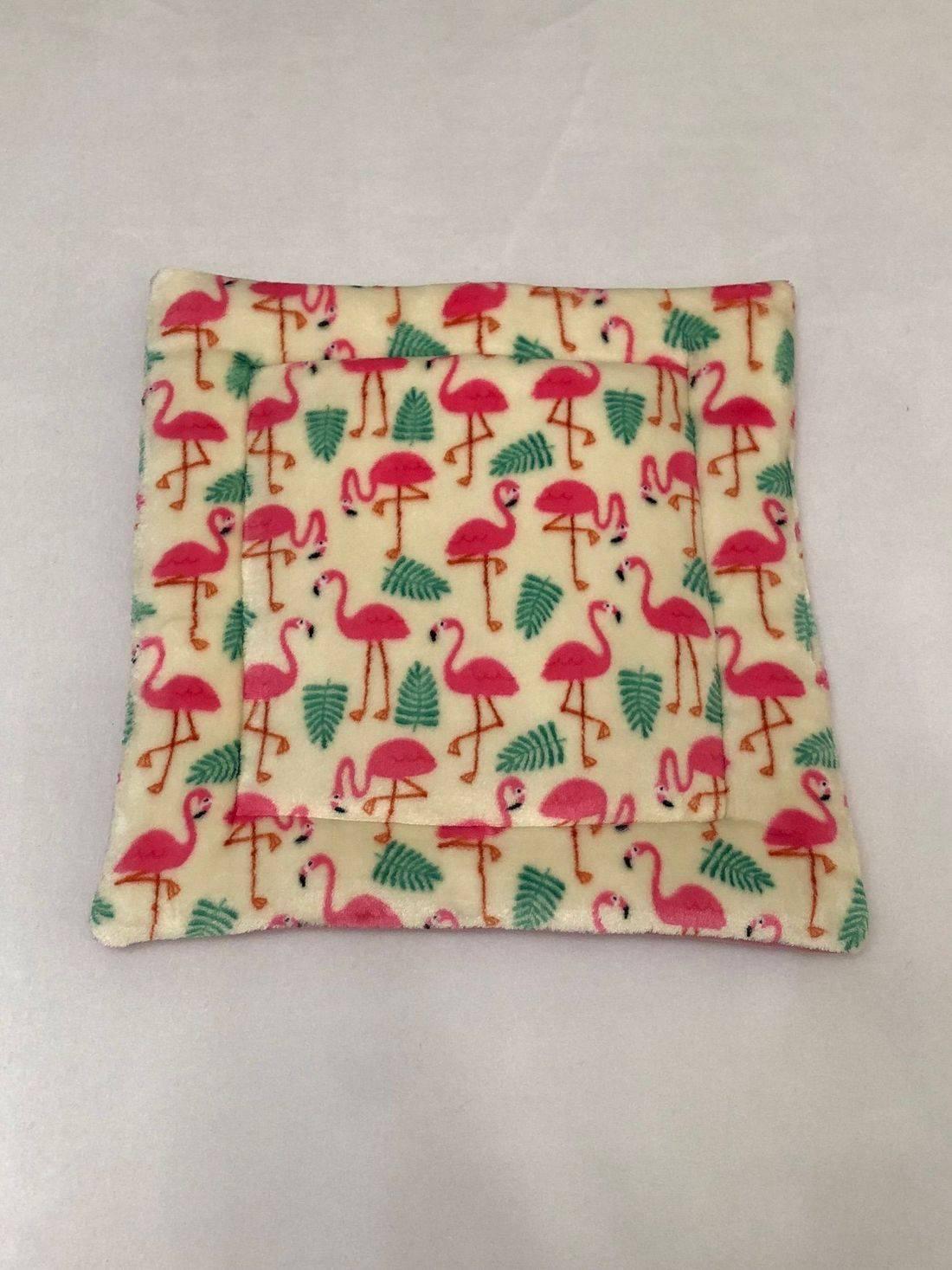 cream flamingo lap pad guinea pig