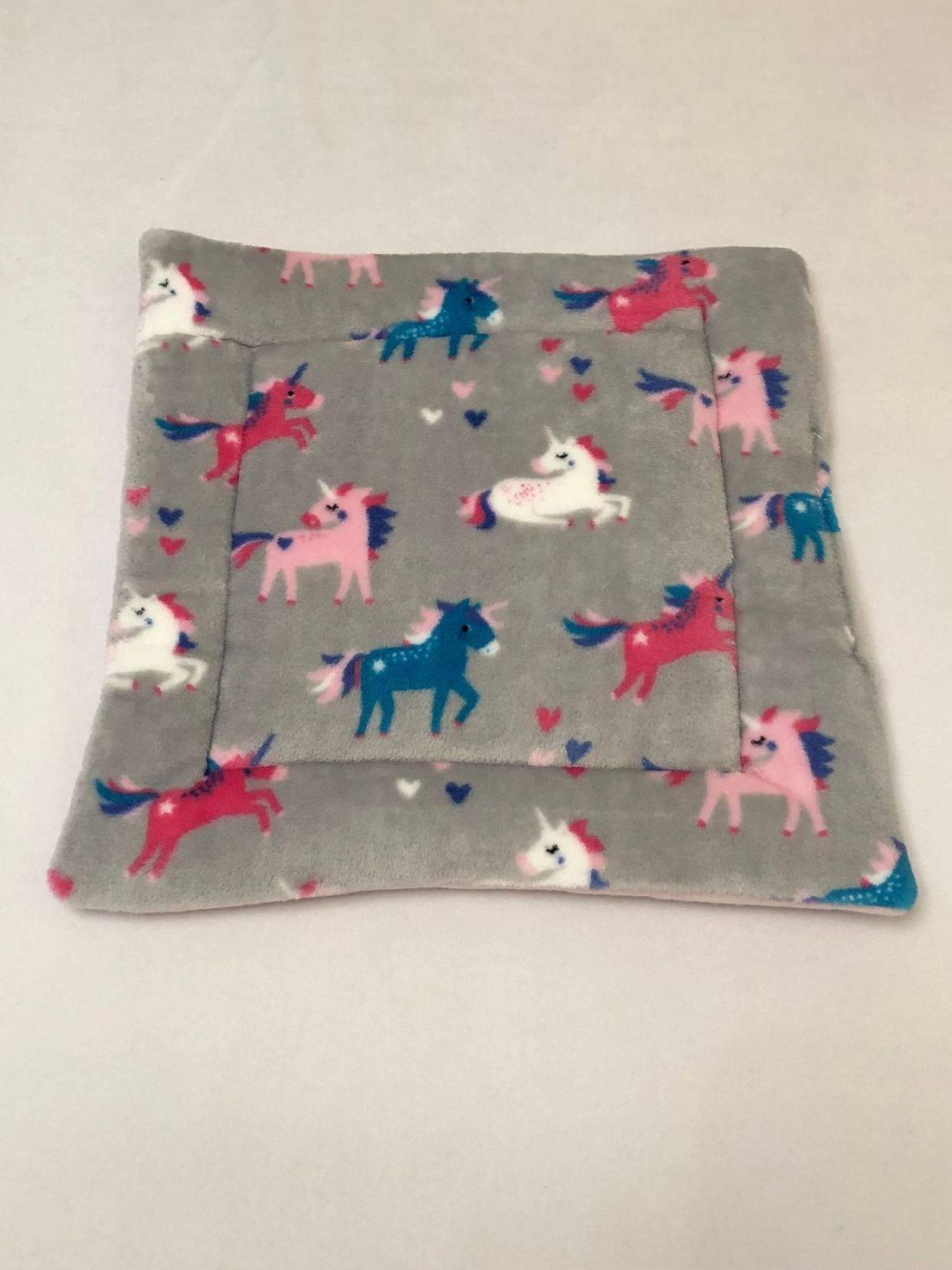 grey unicorn lap pad guinea pig
