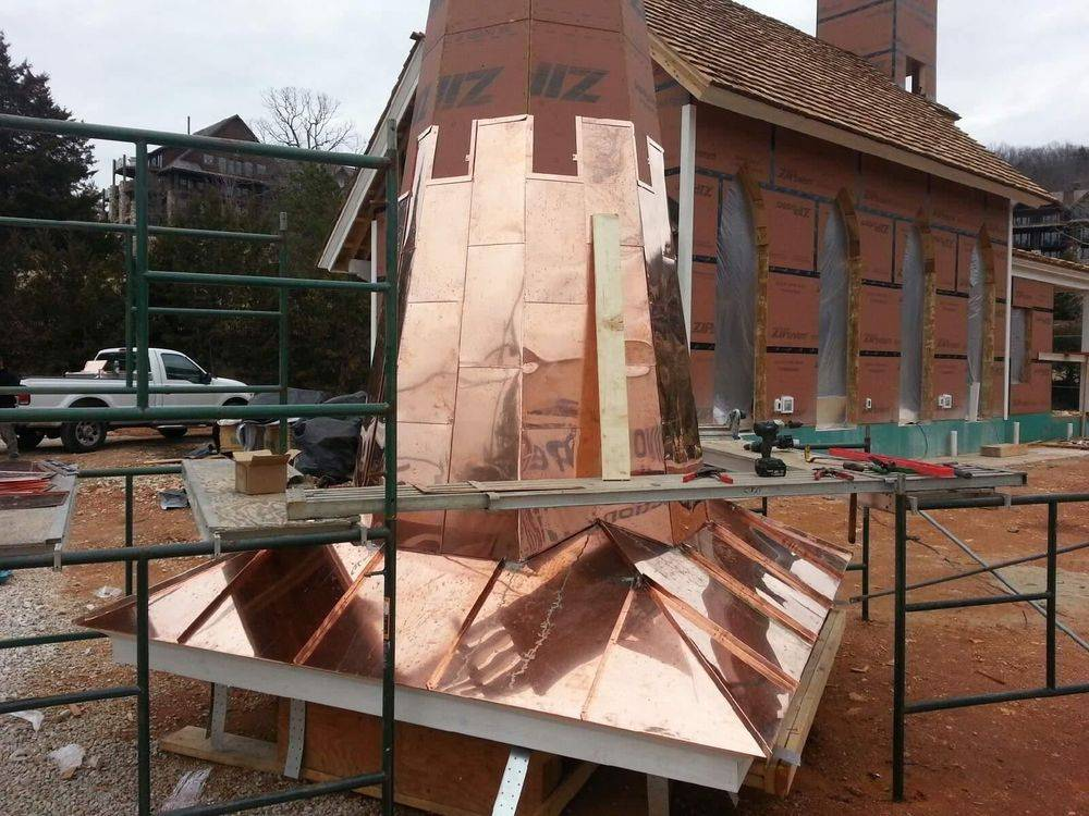 copper installation before completion for top of chapel