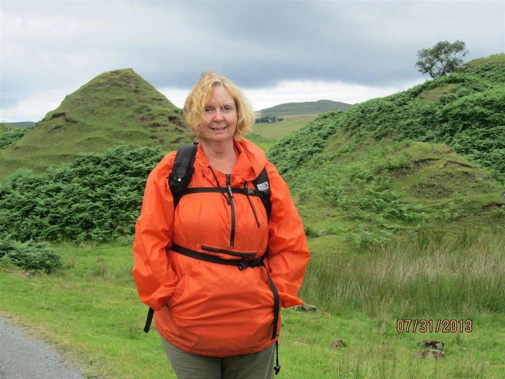 Linda Hogan hiking through the Faery Glen on the Isle of Skye, Scotland