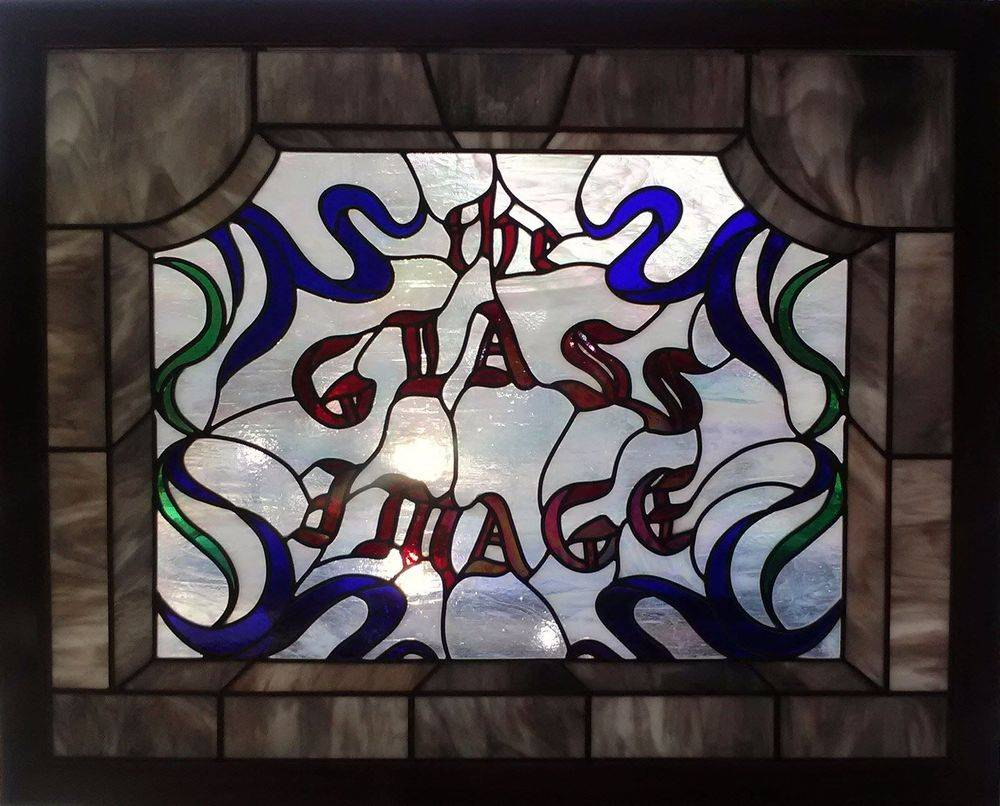 The Glass Image Company Window - Designed and built in 1985. Framed with the exotic wood Purple Heart grown in Central & South America.