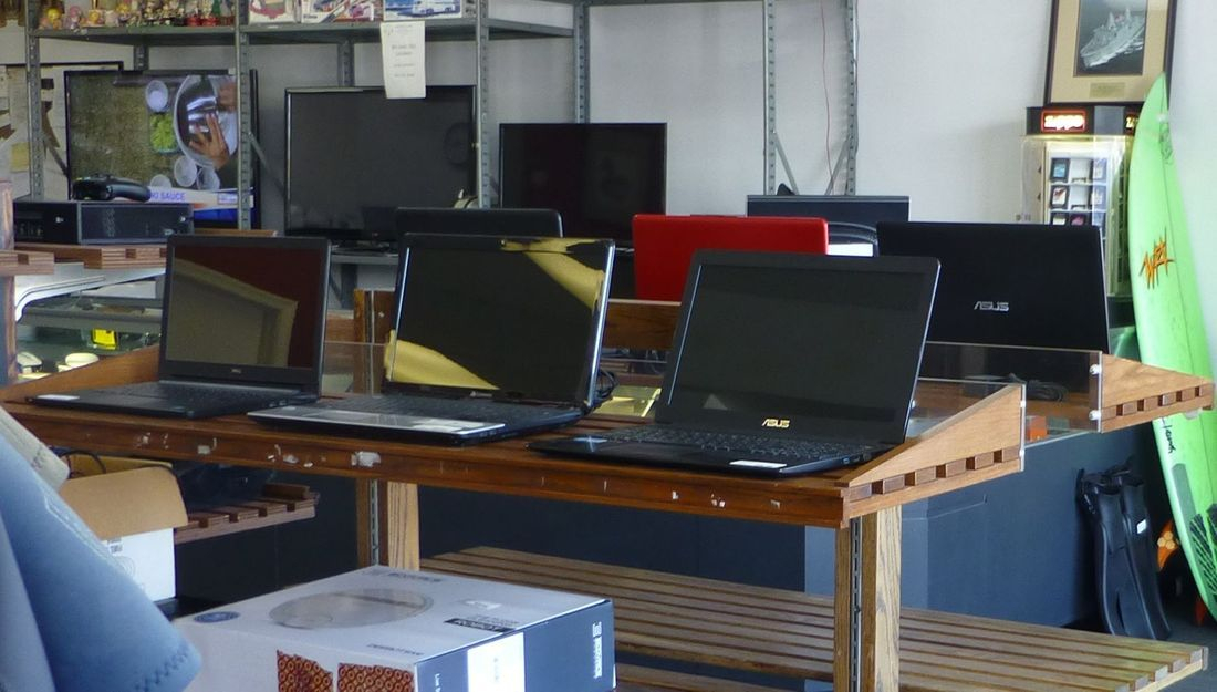 Laptops Electronics Surfboards and T.V's On Display At Kempsville Pawn Shop In Virginia Beach.