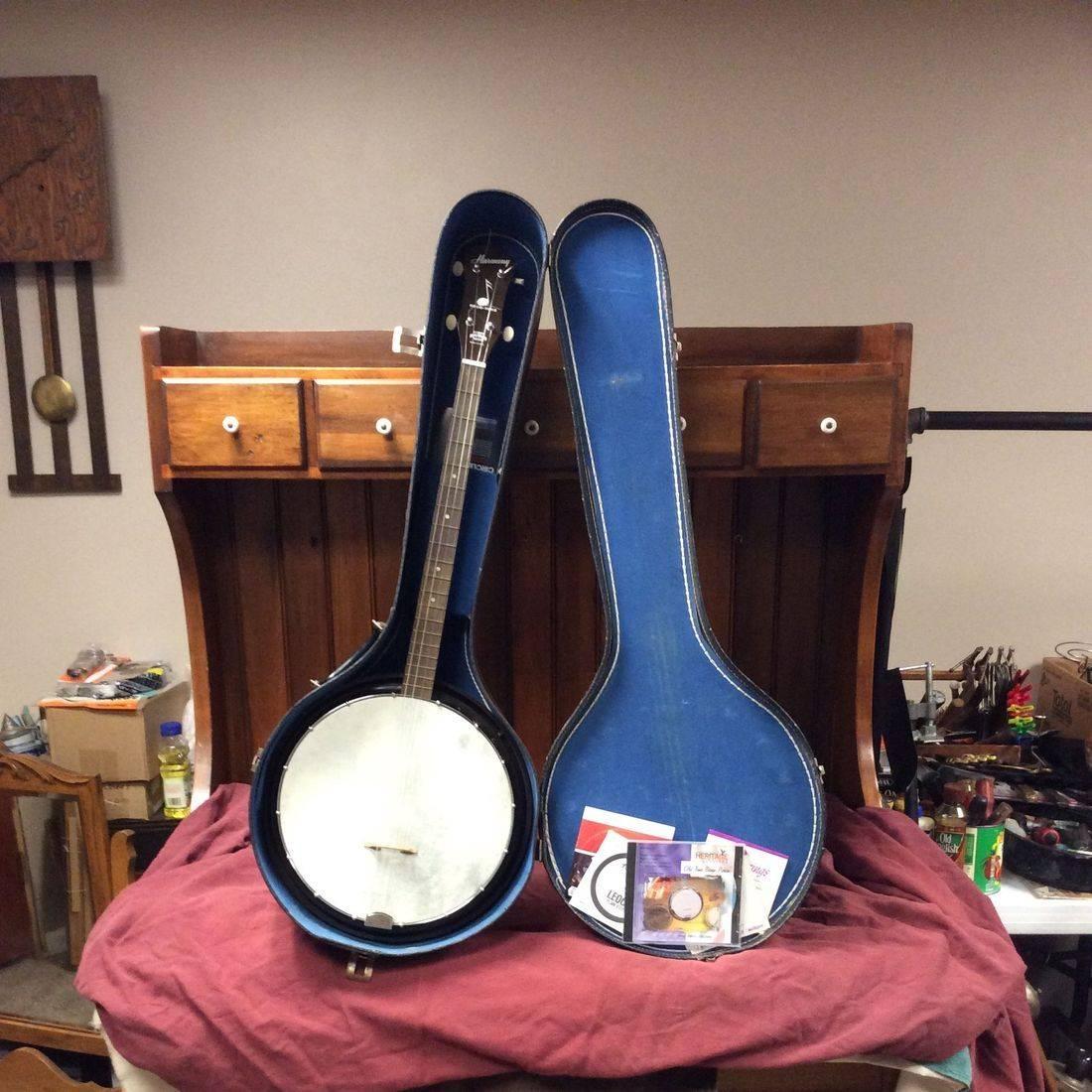 """1950's Harmony Reso-Tone, 4-String Tenor Banjo w/13"""" Bakelite Resonator, Case & Extra Strings  33""""L x 12"""" Dia. Pot $150.00"""