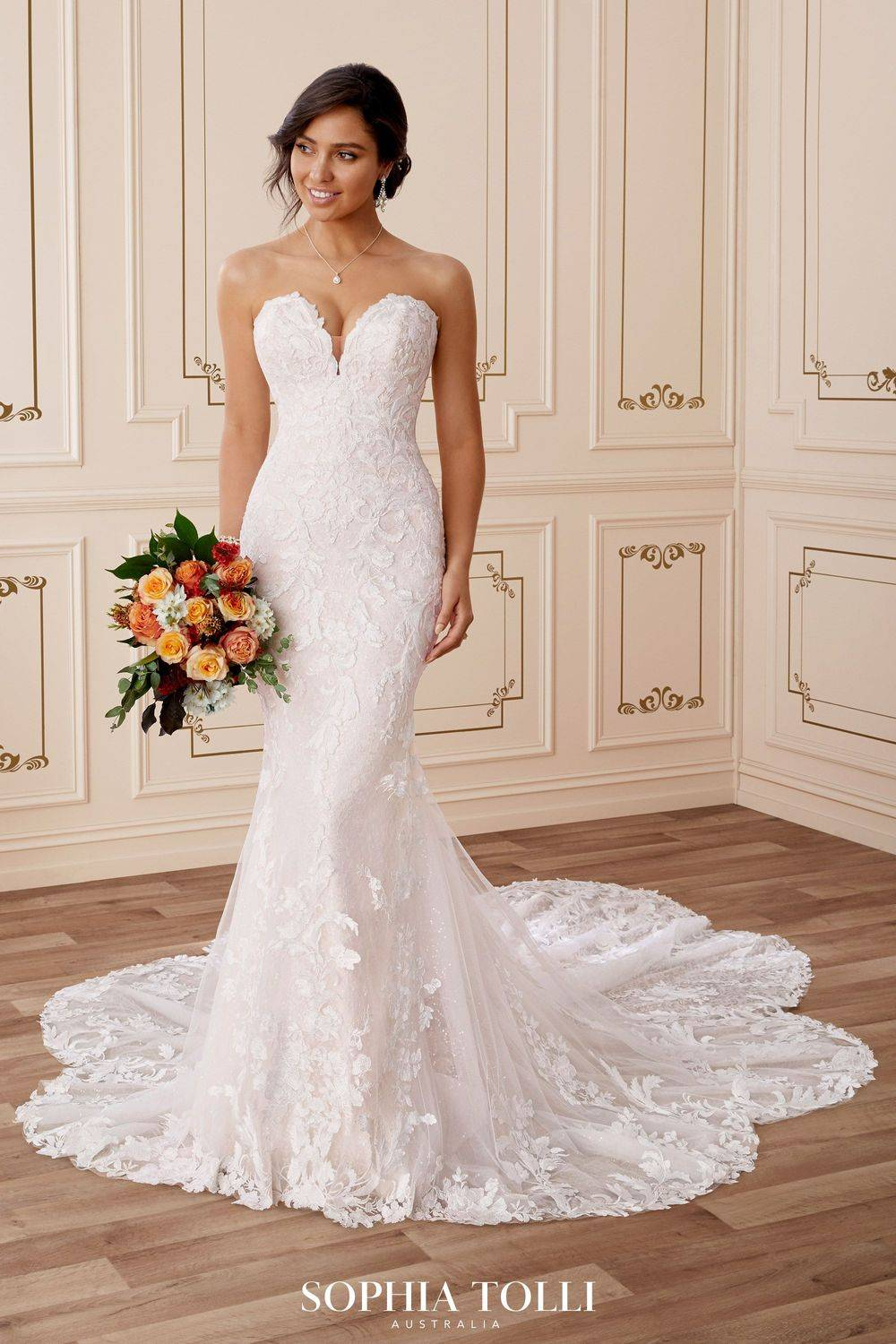 lace fitted wedding dress with sweetheart neckline and dramatic train