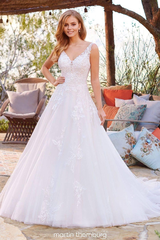 A-line lace wedding dress with v neckline and shoulder straps