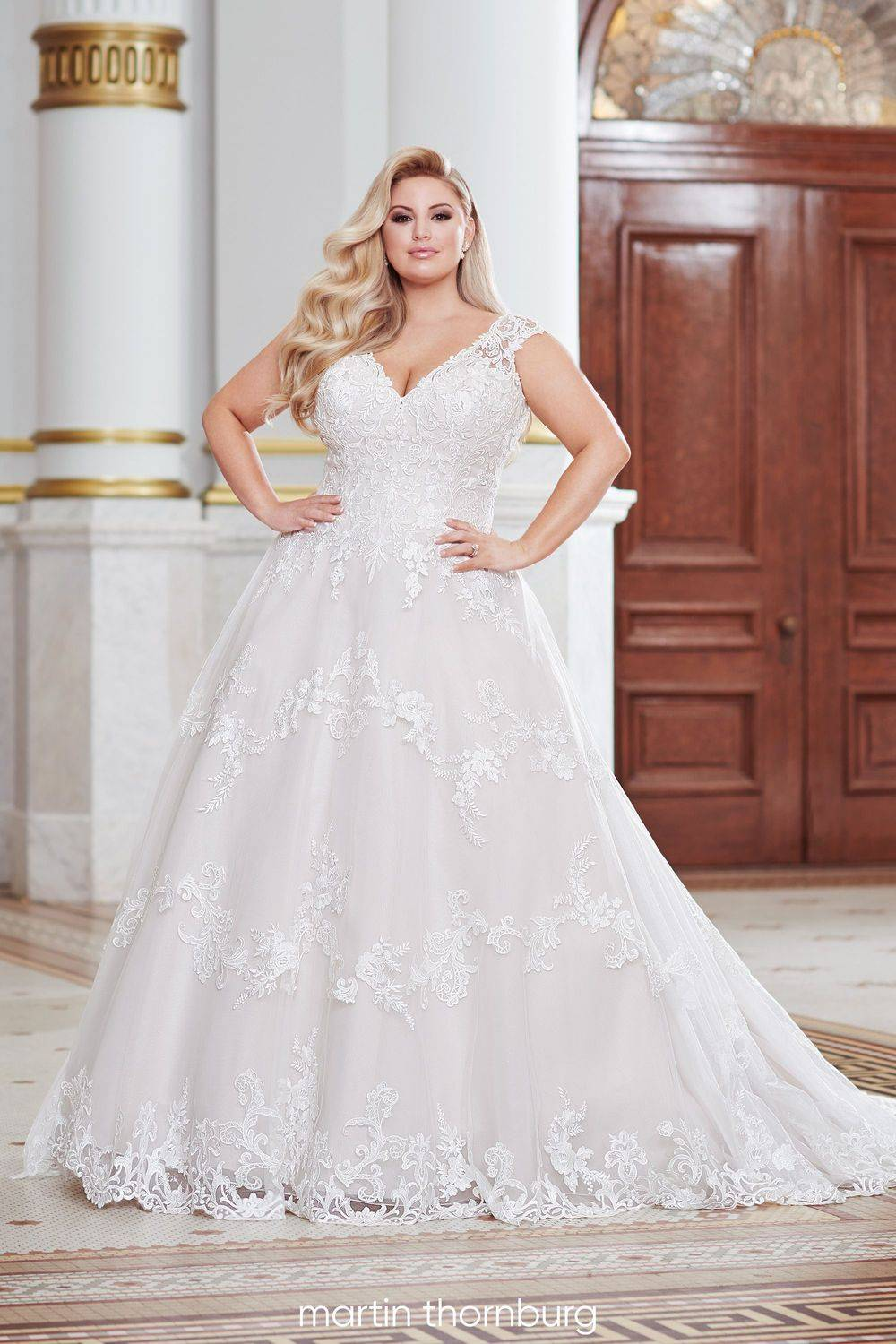 plus size lace wedding dress with capped sleeves and sexy back