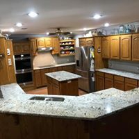 A kitchen with marble countertops