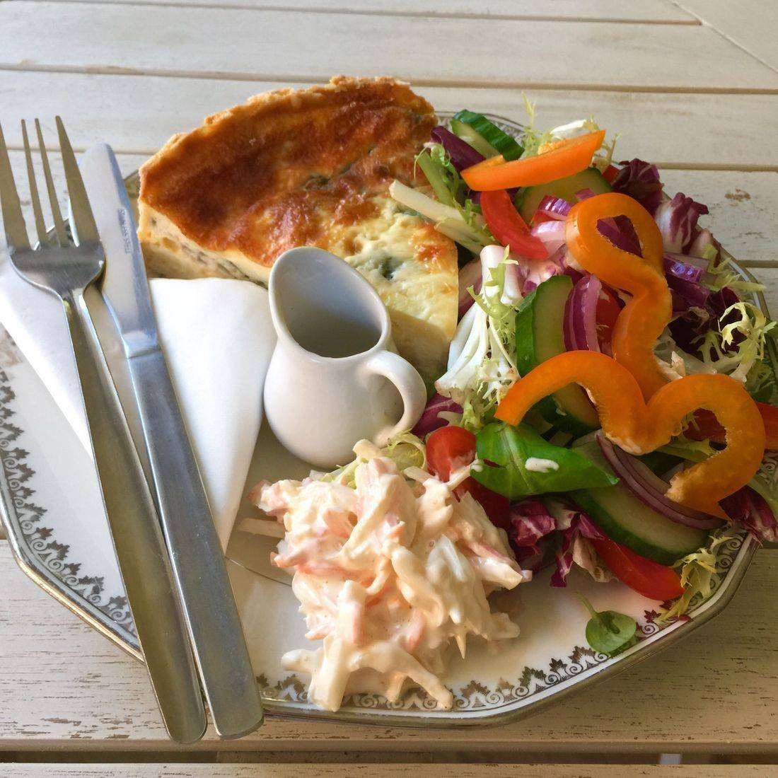 Homemade quiche served with a side salad