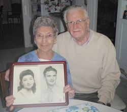 Mr. & Mrs. Liberman with portraits of themselves in their youth
