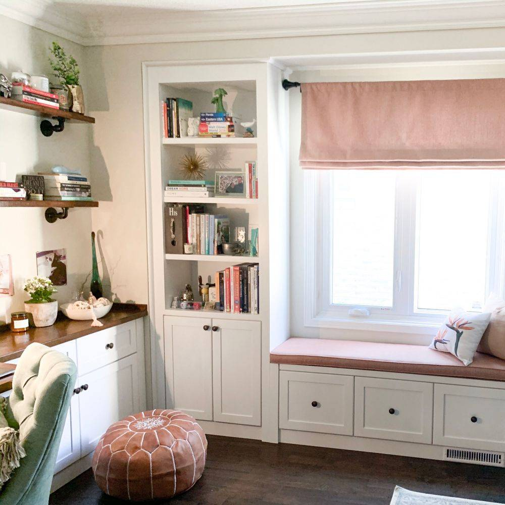 Built in wall shelves with bench seating area under window