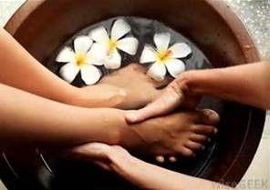 Hands touching feet